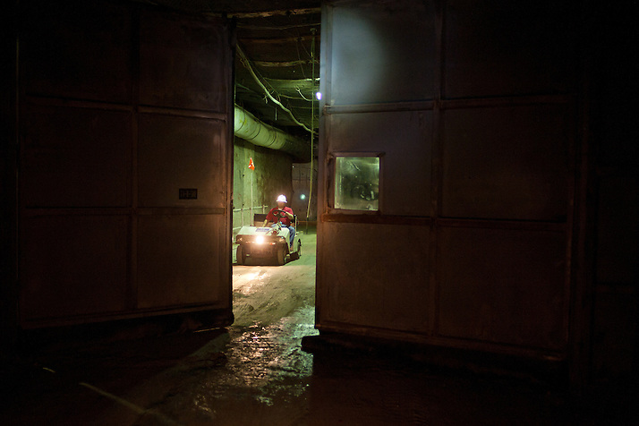 An employee waits for security doors to open 2150 ft underground inside The Waste Isolation Pilot Plant in Eddy County. WIPP received $172 million as part of the Recovery and Reinvestment Act accelerate nuclear waste cleanup. (Steven St. John)
