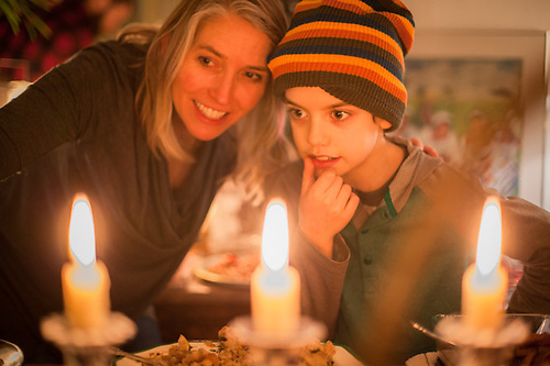 Erin and her son, Sachel, peruse the food before Christmas dinner at Lanie Fleischer's house in Anchorage (© Clark James Mishler)