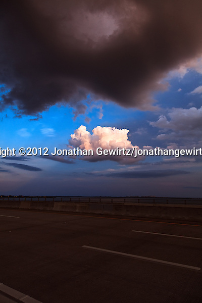 A solitary cloud over Key Biscayne is illuminated by the setting sun in this view from the top of the William Powell bridge, part of Miami's Rickenbacker Causeway. (© 2012 Jonathan Gewirtz / jonathan@gewirtz.net)