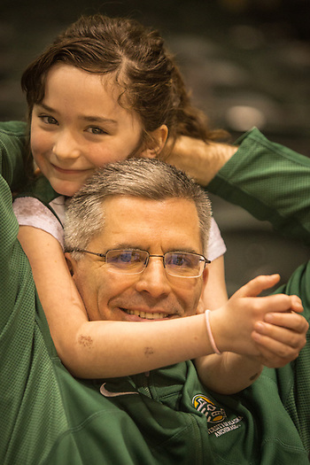 Brendan McMahon and his seven year old daughter, Teresa, at the UAA Men's basketball game at the Alaska Airlines Center, Anchorage (© Clark James Mishler)