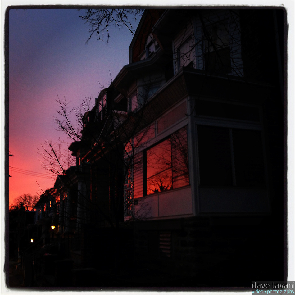 The morning glow reflects in a window on Cherokee Street in the Germantown section of Philadelphia, January 25, 2013. (Dave Tavani)
