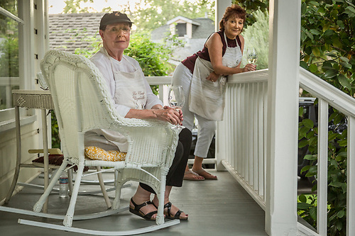 """Dinner's in the oven and we're enjoying a pre-dinner glass of wine on the porch.""  -Liz McNally and her house guest, Maria Marti, enjoy a warm evening in Calistoga. (Clark James Mishler)"