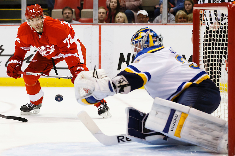 Mar 22, 2015; Detroit, MI, USA; Detroit Red Wings right wing Erik Cole (72) takes a shot on St. Louis Blues goalie Jake Allen (34) in the first period at Joe Louis Arena. Mandatory Credit: Rick Osentoski-USA TODAY Sports (Rick Osentoski/Rick Osentoski-USA TODAY Sports)