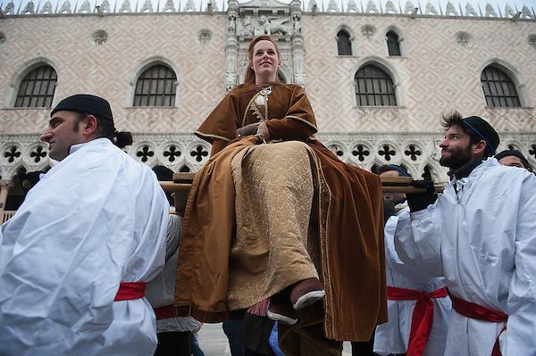 VENICE, ITALY - FEBRUARY 11:  The traditional parade of '12 beautiful Venetian girls' forms part of the Festa delle Marie in St Mark's Square on February 11, 2012 in Venice, Italy.The annual festival, which lasts nearly three weeks, will see the streets and canals of Venice filled with people wearing highly- (Marco Secchi)