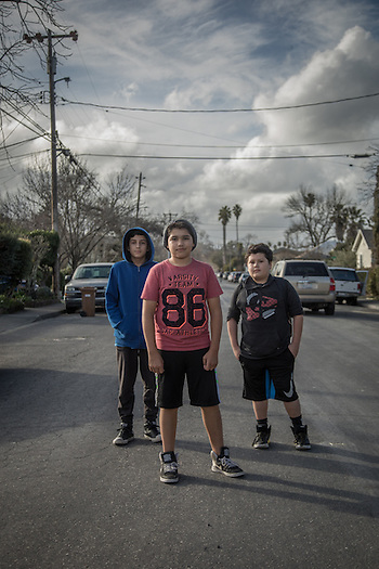 Twelve year old friends Jorge Robledo, Jose Vega and Bernardo Cruz stand on Washington Street in Calistoga. (© 2017 Clark James Mishler)