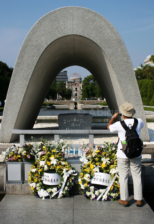 Hiroshima Peace Memorial Park - Man takes photo of the A dome