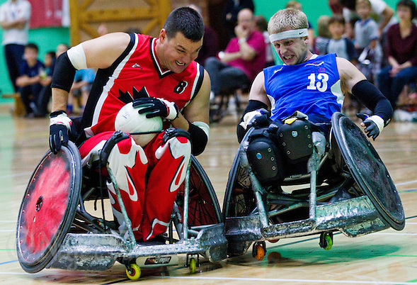 15 AUG 2011 - LEEDS, GBR - Great Britain's Aaron Phipps (right) collides with Canada's Mike Whitehead during the wheelchair rugby exhibition match between Great Britain and Canada .(PHOTO (C) NIGEL FARROW) (NIGEL FARROW/(C) 2011 NIGEL FARROW)
