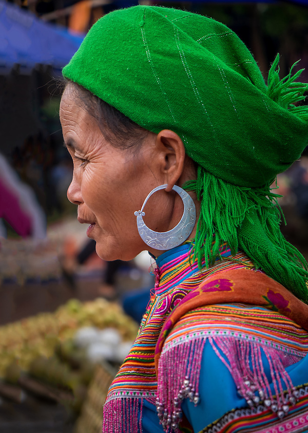 BAC HA, VIETNAM - CIRCA SEPTEMBER 2014:  Profile of Hmong woman at the  Bac Ha sunday market, the biggest minority people market in Northern Vietnam (Daniel Korzeniewski)
