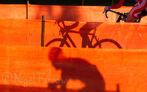 03 NOV 2012 - IPSWICH, GBR - A competitor makes her way through a zig-zag section of the course marked with orange scrim during the Elite Women's European Cyclo-Cross Championships in Chantry Park, Ipswich, Suffolk, Great Britain .(PHOTO (C) 2012 NIGEL FARROW) (NIGEL FARROW/(C) 2012 NIGEL FARROW)