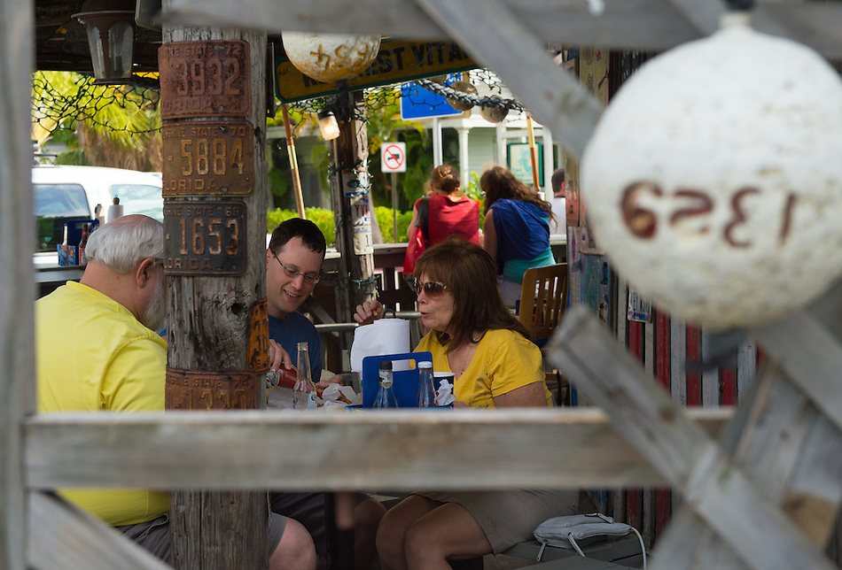 KEY WEST, FL - CIRCA 2012: Patrons on famous Bo's Fish Wagon  a landmark in Key West circa 2012. The tropical city is a popular tourist destination with over 2 million yearly visitors. (Daniel Korzeniewski)