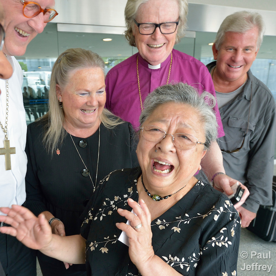 Koko Kondo, a survivor of the 1945 atom bomb dropped on Hiroshima, Japan, laughs on August 7, 2015, as she talks with a delegation of church leaders from around the world who have come to see for themselves the suffering caused by the bomb, to listen to the survivors and to local church leaders, and to return home recommitted to advocating for an end to nuclear weapons. The delegation of pilgrims was organized by the World Council of Churches. Kondo is a well-known hibakusha, or atom bomb survivor, who along with her father is mentioned in John Hershey's landmark book about the horror of Hiroshima. (Paul Jeffrey)