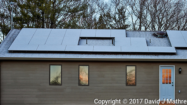 South facing solar panels with a light coating of snow. Winter Nature in New Jersey. Image taken with a Nikon Df camera and 70-200 mm f/2.8 lens (ISO 400, 70 mm, f/2.8, 1/400 sec). (David J Mathre)