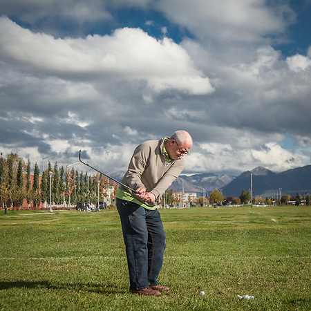 "Economist Marcus Hartley takes a break from work at his office to hit a few balls on the Delaney Park Strip on, this, the first day of fall.  ""There won't be too many more days for this…""  marcushartley@yahoo.com (© Clark James Mishler)"