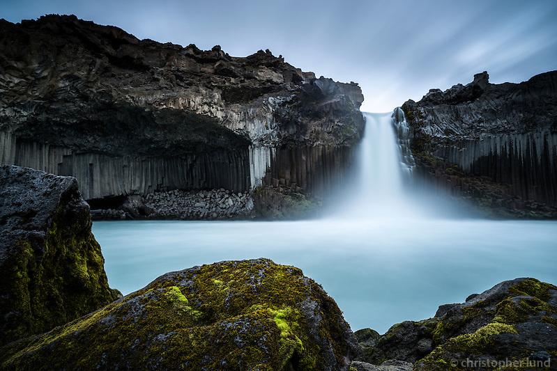The Aldeyjarfoss waterfall is situated in the north of Iceland at the northern part of the Sprengisandur Highland Road which means it is to be found within the Highlands of Iceland. One of the most interesting features of the waterfall is the contrast between the black basalt columns and the white waters of the fall. The river Skjálfandafljót drops here from a height of 20 m. The basalt belongs to a lava field called Frambruni or Suðurárhraun, hraun being the Icelandic designation for lava. (Christopher Lund/©2012 Christopher Lund)