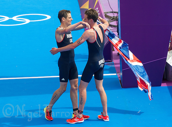 07 AUG 2012 - LONDON, GBR - Alistair Brownlee (GBR) of Great Britain (right) is congratulated on his victory by his brother, bronze medalist Jonathan Brownlee (left) after the men's London 2012 Olympic Games Triathlon in Hyde Park in London, Great Britain (PHOTO (C) 2012 NIGEL FARROW) (NIGEL FARROW/(C) 2012 NIGEL FARROW)