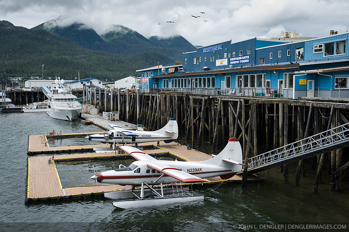 Two de Havilland DHC-3 Otter float planes are docked in the Juneau Harbor next to the Merchant's Wharf Mall in downtown Juneau, Alaska. Float planes are a vital mode of transportation in Alaska where much of the state is only accessable by float plane. (John L. Dengler)