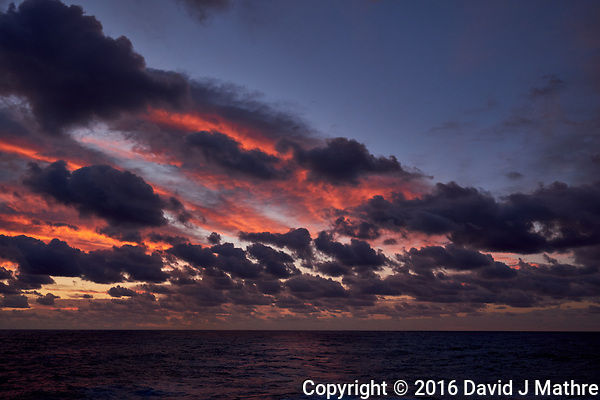 Colorful Dawn clouds over the Pacific Ocean from the deck of the MV World Odyssey. Image 4 of 6 taken with a Fuji X-T1 camera and 23 mm f/1.4 lens (ISO 200, 23 mm, f/5.6, 1/60 sec). Raw images processed with Capture One Pro. (David J Mathre)