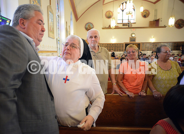 BRISTOL, PA - MAY 31:  Ralph DiGuiseppe of Bristol, Pennsylvania is hugged by Sister Mary Donald, O. SS. T after the closing of St. Ann's parish is announced May 31, 2014 in Bristol, Pennsylvania. (Photo by William Thomas Cain/Cain Images) (William Thomas Cain)