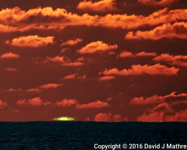 """Green Flash"" as the sun drops into the Sea from the Deck of the MV World Odyssey. Image taken with a Nikon 1 V3 camera and 70-300 mm lens (ISO 200, 300 mm, f/11, 1/250 sec). (David J Mathre)"
