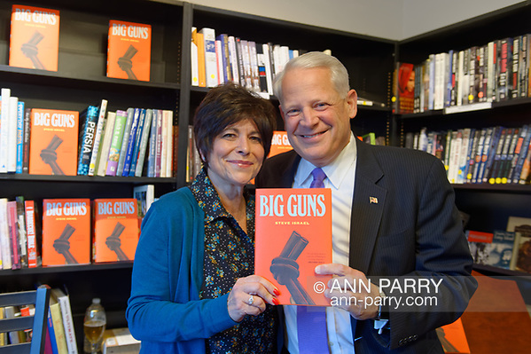 Rockville Centre, New York, USA. April 20, 2018. R-L, Author STEVE ISRAEL and Moderator RITA KESTENBAUM hold Israel's newest novel BIG GUNS at special event for the former Congressman's book at Turn of the Corkscrew Books & Wine. (© 2018 Ann Parry/Ann-Parry.com)