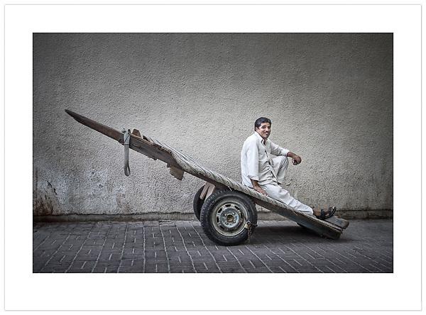 Man with Cart - Deira, Dubai, 2013 (© Ian Mylam)