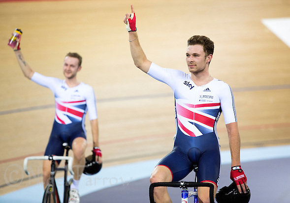 06 DEC 2014 - STRATFORD, LONDON, GBR - Owain Doull (GBR) of Great Britain and his team mate Mark Christian (GBR) (left) celebrate their victory in the 2014 UCI Track Cycling World Cup Madison race at the Lee Valley Velo Park in Stratford, London, Great Britain  (PHOTO COPYRIGHT © 2014 NIGEL FARROW, ALL RIGHTS RESERVED) (NIGEL FARROW/COPYRIGHT © 2014 NIGEL FARROW : www.nigelfarrow.com)