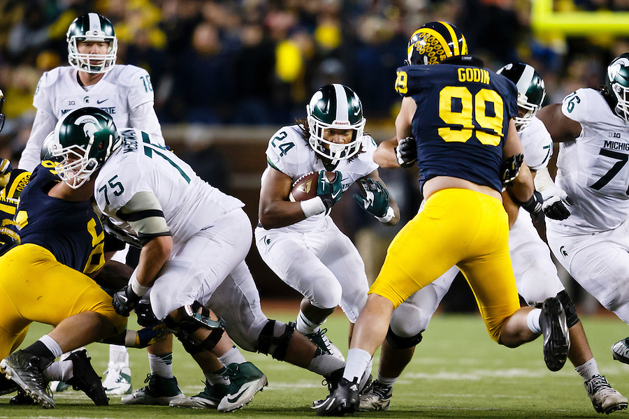 Oct 17, 2015; Ann Arbor, MI, USA; Michigan State Spartans running back Gerald Holmes (24) rushes against the Michigan Wolverines at Michigan Stadium. Mandatory Credit: Rick Osentoski-USA TODAY Sports (Rick Osentoski/Rick Osentoski-USA TODAY Sports)