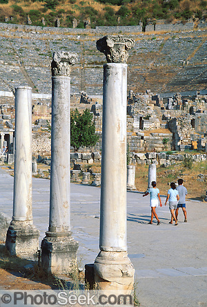 Visitors walk beneath Corinthian order columns at the Great Theatre of Ephesus, in the Republic of Turkey.