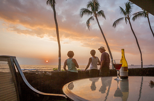Darlene, Mitzi, and Bart enjoy sunset, Kialua, Kona, Hawaii (Clark James Mishler)