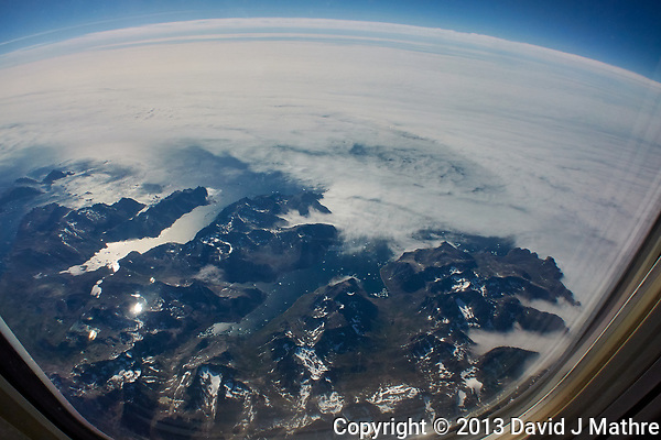 Greenland From 35000 Feet. Return Flight from Iceland. Image taken with a Nikon 1 V2 camera and 10 mm f/2.8 lens (ISO 160, 10 mm, f/9, 1/640 sec). Raw image processed with Capture One Pro, Focus Magic, and Photoshop CC. (David J Mathre)