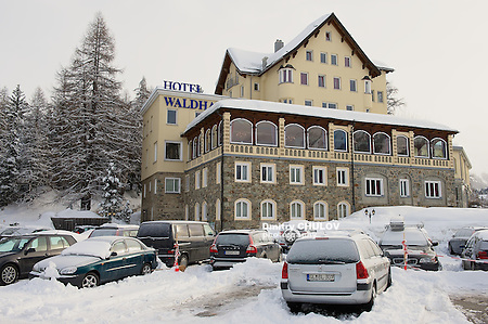 ST.MORITZ, SWITZERLAND - MARCH 06, 2009: View to the cars parked in front of the Waldhaus am See hotel in Saint Moritz, Switzerland. (Dmitry Chulov)