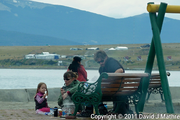 Refuges Living Rough on the Street of Puerto Natales Cooking Lunch. Snapshot taken with a Leica V-Lux 20 camera (ISO 80, 49.2 mm, f/4.9, 1/250 sec). (David J Mathre)