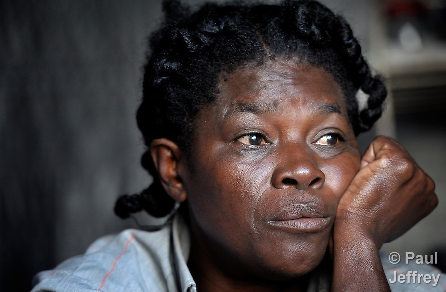 Remilliene Morris, a 52-year old earthquake survivor in Port au Prince, Haiti, sits sadly in her temporary shelter in the Petionville Camp. With some 50,000 residents packed onto what was once a golf course, it's the largest camp of hundreds of locales hosting more than a million people left homeless by the January 12, 2010 quake. After her rented home collapsed in the quake, Morris sent two of her four children to live with relatives in the north of the country. Now she struggles to find the school fees for her other two children. She has received donated food and worked occasionally in a cash for work program, but lives in ragged clothing and sews together her family's shoes with scavenged string. Morris she gets depressed by the continuing struggle to survive.