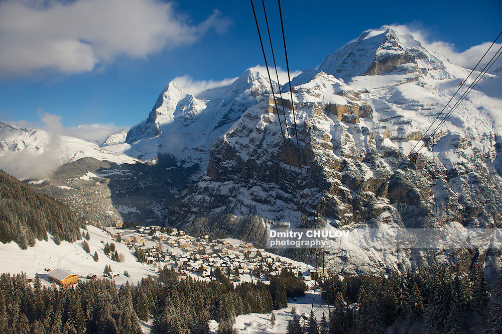 MURREN, SWITZERLAND - DECEMBER 08, 2009: Winter mountain view to Murren village and ski resort from cable car to Schilthorn in Murren, Switzerland. (Dmitry Chulov)