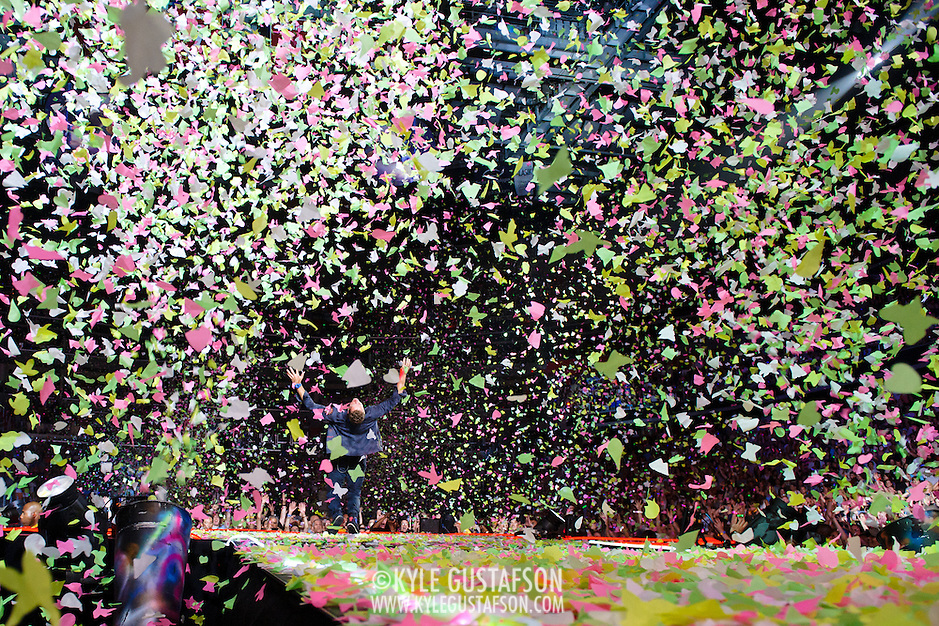 WASHINGTON, DC - July 9th, 2012 - Chris Martin of Coldplay performs as confetti cannons spray at the Verizon Center in Washington, D.C. The band's 2011 album, Mylo Xyloto, reached number one in thirty countries. (Photo by Kyle Gustafson/For The Washington Post) (Kyle Gustafson/For The Washington Post)