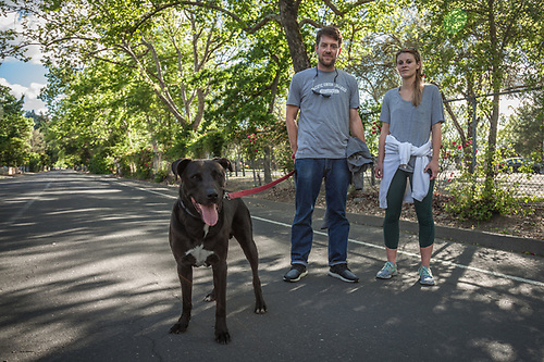 Pacific Union College Athletic Director Brittany Brown with her boyfriend, Michael Norman, and their dog, Zeus, near their home in Calistoga (Clark James Mishler)