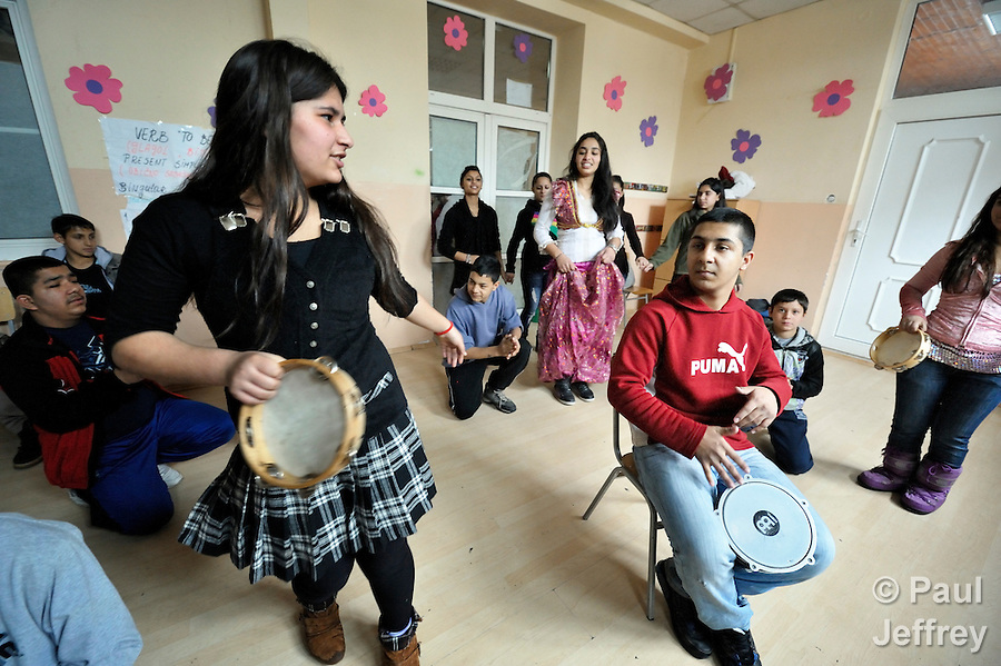Bajram Kruezi (right) plays a drum as other students dance to traditional Roma music in the Branko Pesic School, an educational center for Roma children and families in Belgrade, Serbia, which is supported by Church World Service. Kruezi's family came to Belgrade as refugees from Kosovo, and like many Roma can't afford regular school fees. Many Roma also lack legal status in Serbia, and thus have difficulty obtaining formal employment and accessing government services.