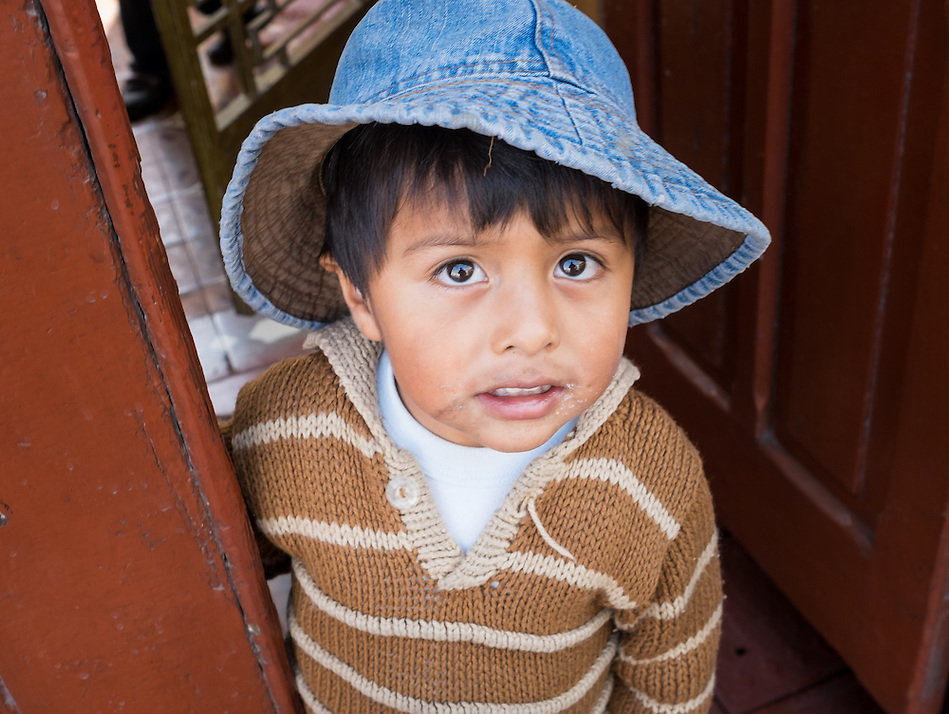AREQUIPA, PERU - CIRCA APRIL 2014: Portrait of Peruvian kid in the streets of Arequipa. Arequipa is the Second city of Perú by population with 861,145 inhabitants and is the second most industrialized and commercial city of Peru. (Daniel Korzeniewski)