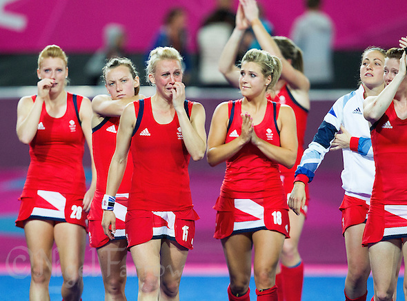 08 AUG 2012 - LONDON, GBR - Alex Danson (GBR) (third from left), Georgie Twigg (GBR) (fourth from left) and their Great Britain team mates show how much losing means as they show their appreciation to the spectators after their London 2012 Olympic Games semi final hockey match against Argentina at the Riverbank Arena in Stratford, London, Great Britain (PHOTO (C) 2012 NIGEL FARROW) (NIGEL FARROW/(C) 2012 NIGEL FARROW)