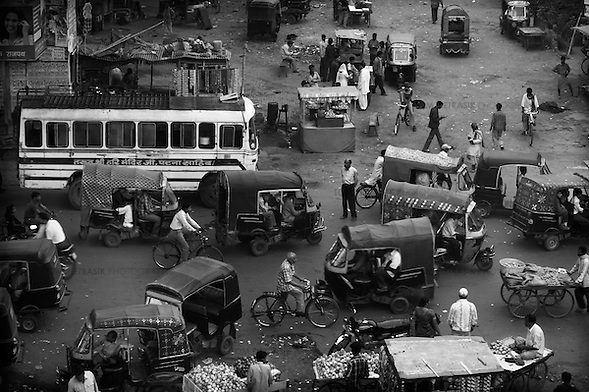 Evening activity at Patna's Gia Ghat neighbourhood, close to the banks of the Ganges river. This area has become an informal terminal where inter-district buses pass into the city. Migrating communities provide potential for the polio virus to spread from district to district and transit points like these are a focus for Unicef's polio vaccination effort...India is one of only four countries in the world reported to suffer endemic polio. Only 66 new cases of the disease were reported in India in 2005. But in 2006 that figure leapt ten-fold. In September, UN Secretary General Kofi Annan wrote to Indian Prime Minister Manmohan Singh expressing concern at the new polio outbreak. The Indian government, together with partners including Unicef and Rotary International has embarked on a renewed effort to eradicate polio. Overcrowded areas of poor sanitation are particularly susceptible to the virus. Focusing on the poor north Indian states of Uttar Pradesh and Bihar which between them are home to more than 250 million people, Unicef is coordinating the largest public health drive in the world. The task is to vaccinate all children under the age of five during a series of vaccination rounds. Unicef has mobilised thousands of volunteers to administer and supervise the vaccination effort. Unicef has also recruited people with influence to encourage communities to have their children protected against polio. Misinformation, rumours and a frustration with the lack of other health services mean that many households, particularly in Muslim areas, resist vaccination. ..Photo: Tom Pietrasik.Patna, Bihar, India..November 17th 2006 (Tom Pietrasik)