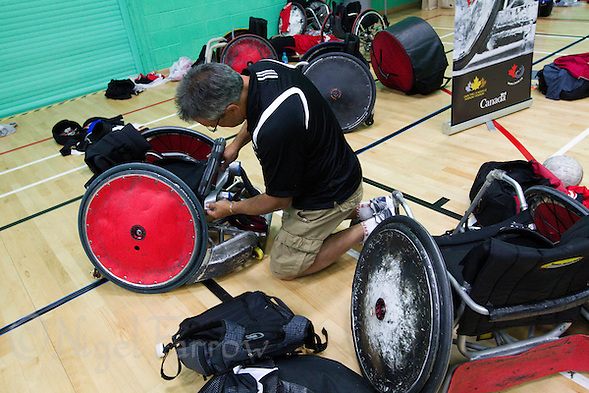 15 AUG 2011 - LEEDS, GBR - Canadian Equipment Manager Bob Hirschfield carries out a repair before the wheelchair rugby exhibition match against Great Britain (PHOTO (C) NIGEL FARROW) (NIGEL FARROW/(C) 2011 NIGEL FARROW)
