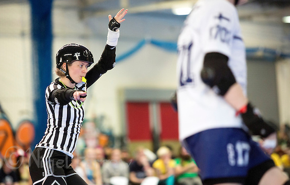 16 MAR 2014 - BIRMINGHAM, GBR - Referee Cherry Fury signals the lead jammer during a jam in the bout between Finland and Ireland at the inaugural Men's Roller Derby World Cup in the Futsal Arena in Birmingham, West Midlands, Great Britain (PHOTO COPYRIGHT © 2014 NIGEL FARROW, ALL RIGHTS RESERVED) (NIGEL FARROW/COPYRIGHT © 2014 NIGEL FARROW : www.nigelfarrow.com)