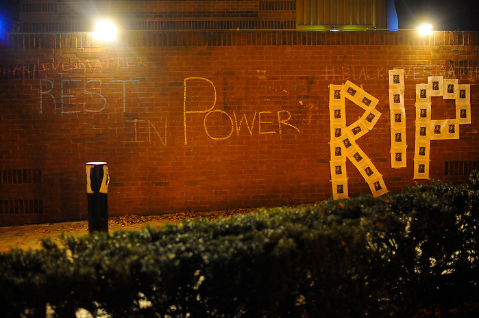 11/25/14 – Medford/Somerville, MA – Tufts student chalk this wall outside the campus center after the Ferguson indictment decision announcement on November 25th, 2014. (Nicholas Pfosi / The Tufts Daily) (Nicholas Pfosi / The Tufts Daily)