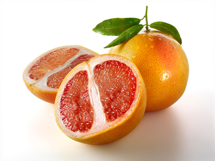 Fresh whole and cut pink grapefruit (Paul Randall Williams)