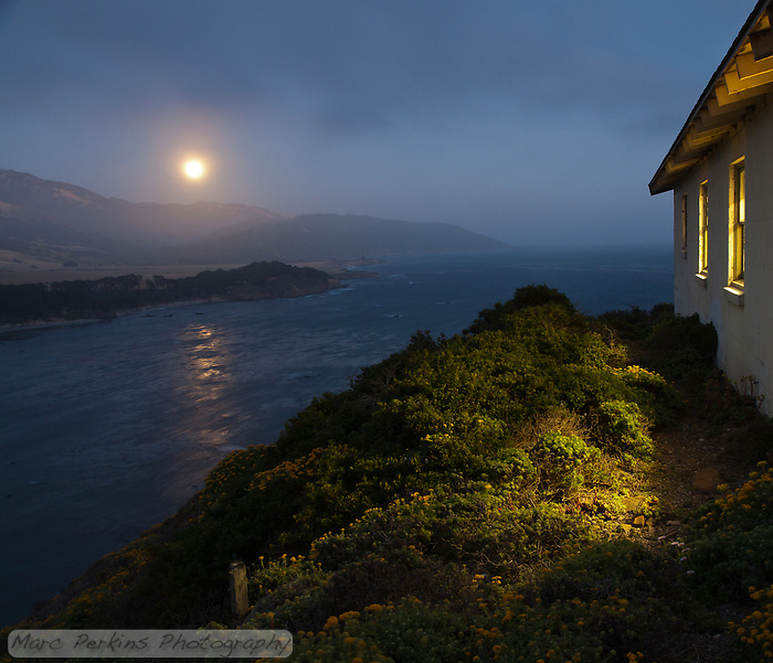The rising full moon is reflected off of the Pacific Ocean within view of one of the buildings at Point Sur Light Station (the barracks).  I love how golden light streams out of the building's windows, illuminating the native plants on the hillside.  This image is the ultimate summary of the station's moon rise tours: they're just gorgeous, and you should go on one if you can! (Marc C. Perkins)