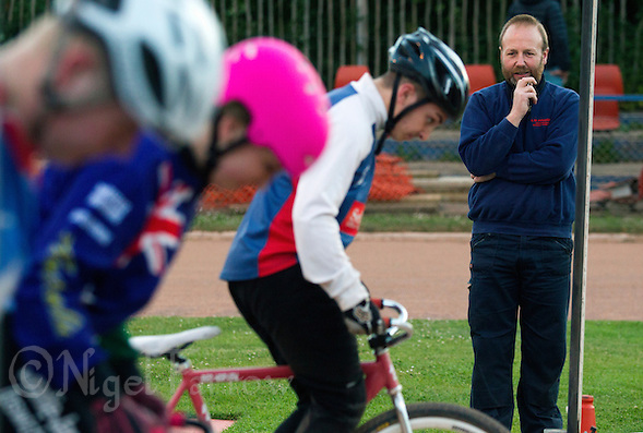 02 JUN 2015 - IPSWICH, GBR - Ipswich Cycle Speedway Coach Les Fellgett watches squad members practice their starting skills during a training session at the club's track at Whitton Sports and Community Centre in Ipswich, Suffolk, Great Britain (PHOTO COPYRIGHT © 2015 NIGEL FARROW, ALL RIGHTS RESERVED) (NIGEL FARROW/COPYRIGHT © 2015 NIGEL FARROW : www.nigelfarrow.com)