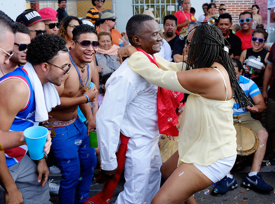 MIAMI - MARCH 9, 2014: People dancing in the streets during the 37th Calle Ocho festival, an annual event that takes place over Eighth Street in Little Havana featuring plenty of music, food, and  it is the biggest party in town that celebrates hispanic heritage. (Daniel Korzeniewski)