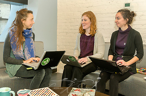 Eileen Schaeffer, Lexie Lipham, and Erin Luce, of the AmeriCorps VISTA Urban Green Lab, hold a business meeting at the Nashville Entrepreneur Center, Jan. 6, 2015, in Nashville, Tenn. The Entrepreneur Center has become the nucleus of a burgeoning startup movement — largely led by Millennials — in the city. (Photo by Carmen K. Sisson/Cloudybright) (Carmen K. Sisson/Cloudybright)