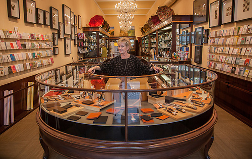 "Sals Associate Patti Phelps at Pennyweight on Main Street in Saint Helena, CA. ""These cases came from a department store in Iowa...all the way to Saint Helena...and all the glass survived."" (Clark James Mishler)"