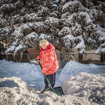 "German imigrant Maitte Pluntke removes snow at the front of her home at 1567 G Street in Anchorage's South Addition neighborhood.  ""We used to have a computer but my husband had a stroke and I got rid of it."" (© Clark James Mishler)"